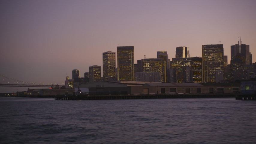 5K stock footage aerial video of the Downtown San Francisco skyline, California, at twilight, seen from the bay Aerial Stock Footage | DFKSF10_074