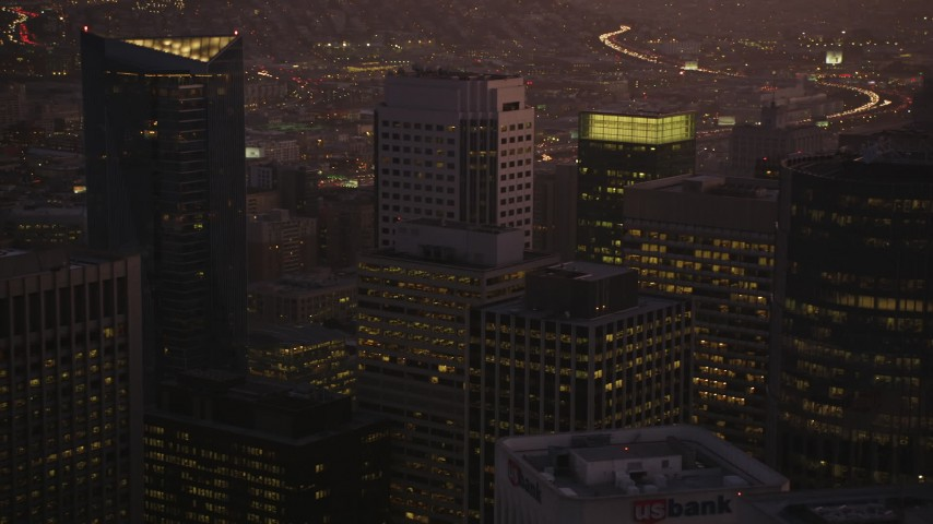 5K stock footage aerial video of flying over city's downtown skyscrapers in Downtown San Francisco, California, twilight Aerial Stock Footage | DFKSF10_075