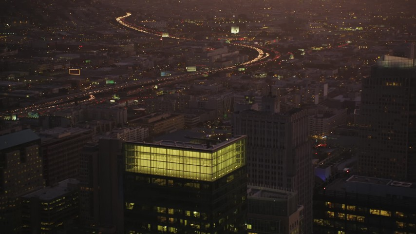 5K stock footage aerial video fly over skyscrapers, reveal freeway and police station in South of Market, San Francisco, California, twilight Aerial Stock Footage | DFKSF10_076