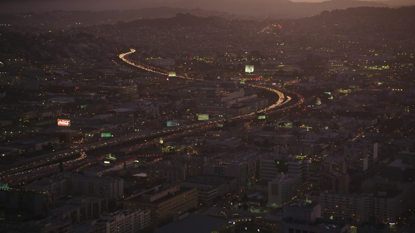 5K stock footage aerial video approach Interstate 80 freeway and police department in South of Market, San Francisco, California, twilight Aerial Stock Footage | DFKSF10_077
