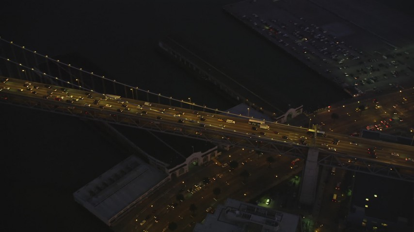 5K stock footage aerial video of heavy traffic on Bay Bridge, San Francisco, California, twilight Aerial Stock Footage | DFKSF10_082