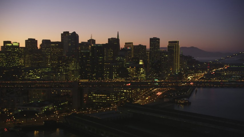 5K stock footage aerial video of the city's skyline and Bay Bridge, Downtown San Francisco, California, twilight Aerial Stock Footage | DFKSF10_084