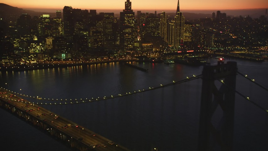 5K stock footage aerial video tilt from the Bay Bridge, revealing Downtown San Francisco skyline, California, twilight Aerial Stock Footage | DFKSF10_088