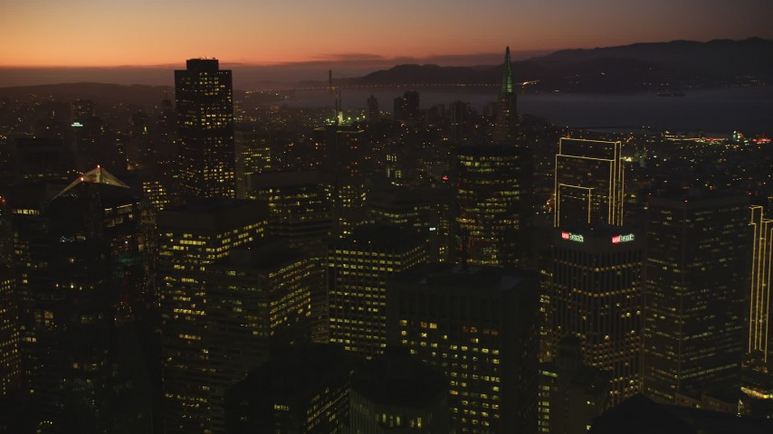 5K stock footage aerial video of panning across skyscrapers in Downtown San Francisco, California, twilight Aerial Stock Footage | DFKSF10_089