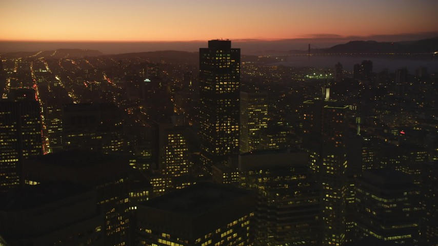 5K stock footage aerial video of flying over and passing the city's tall skyscrapers, Downtown San Francisco, California, twilight Aerial Stock Footage | DFKSF10_090