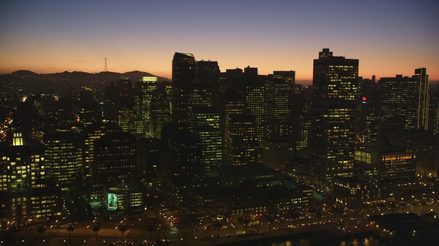 5K stock footage aerial video of passing skyscrapers in Downtown San Francisco, California, twilight Aerial Stock Footage | DFKSF10_091
