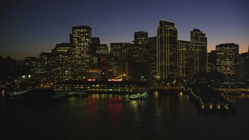 5K aerial video of the Ferry Building and towering skyscrapers in Downtown San Francisco, California, night Aerial Stock Footage | DFKSF10_092