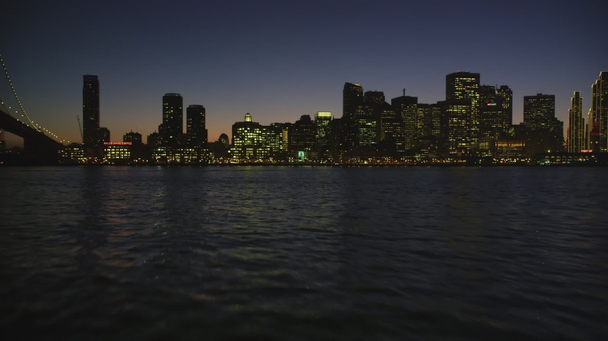 5K stock footage aerial video fly low over bay, pan and approach Downtown San Francisco skyline, California, night Aerial Stock Footage | DFKSF10_095