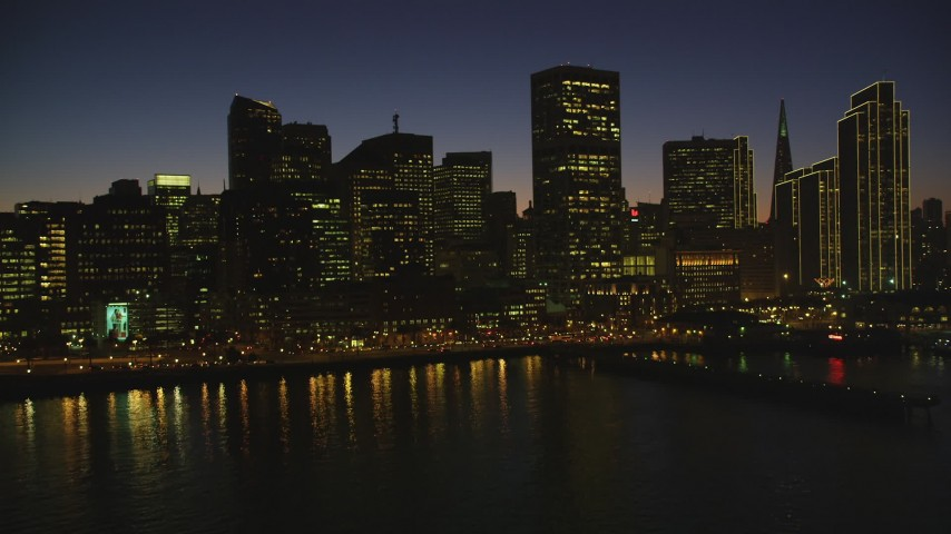 5K stock footage aerial video of approaching skyscrapers while flying over the bay, Downtown San Francisco, California, night Aerial Stock Footage | DFKSF10_096