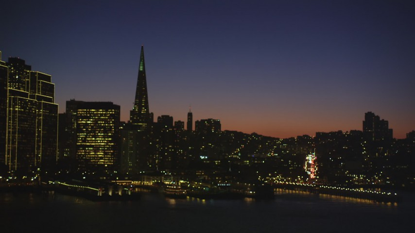 5K stock footage aerial video of flying away from Transamerica Pyramid and skyscrapers in Downtown San Francisco, California, night Aerial Stock Footage | DFKSF10_098