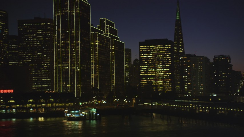 5K stock footage aerial video of flying by Ferry Building and skyscrapers in Downtown San Francisco, California, night Aerial Stock Footage | DFKSF10_101