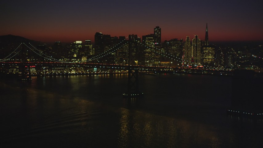 5K stock footage aerial video of the Bay Bridge with Downtown San Francisco skyline in the background, California, night Aerial Stock Footage | DFKSF10_106
