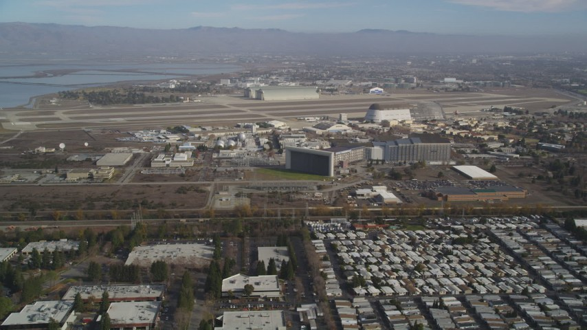 5K stock footage aerial video of flying by Moffett Field and NASA Ames Research Center, Mountain View, California Aerial Stock Footage | DFKSF11_019