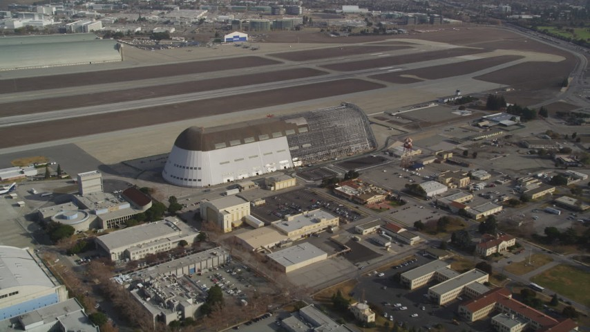 5K stock footage aerial video tilt from NASA Ames Research Center, reveal Hangar One at Moffett Field, Mountain View, California Aerial Stock Footage | DFKSF11_020