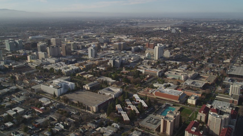 5K stock footage aerial video of flying by San Jose State University and Downtown San Jose, California Aerial Stock Footage | DFKSF12_002