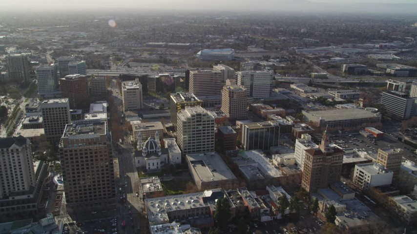 5K stock footage aerial video follow West San Fernando Street past office buildings to Highway 87, Downtown San Jose, California Aerial Stock Footage | DFKSF12_004