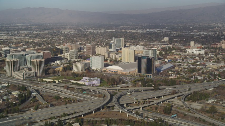 5K stock footage aerial video of convention center in Downtown San Jose, California, seen from freeway interchange Aerial Stock Footage   DFKSF12_006