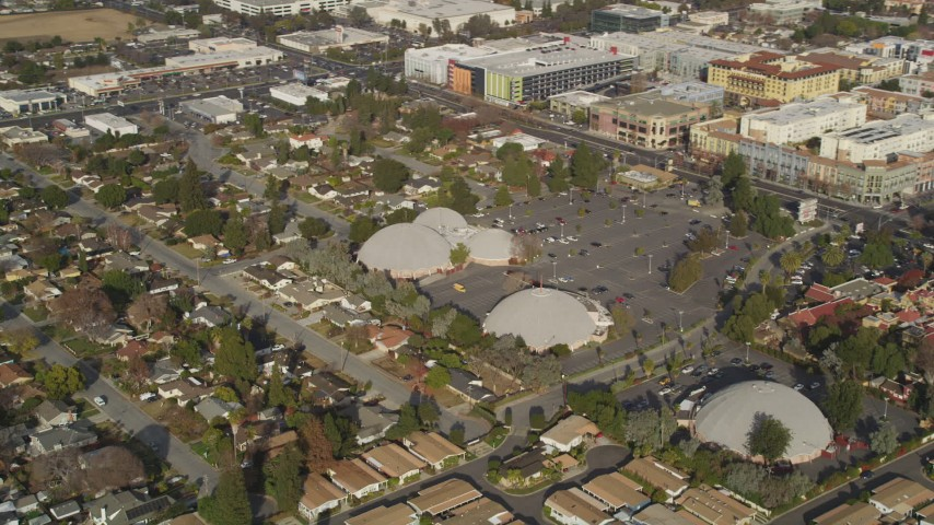5K stock footage aerial video of shopping center, suburban homes, reveal Winchester Mystery House, San Jose, California Aerial Stock Footage | DFKSF12_010