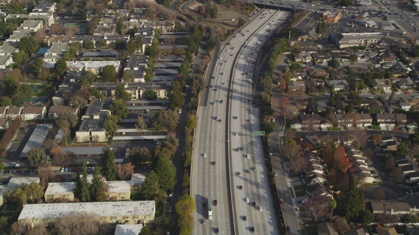 5K stock footage aerial video of a reverse view of I-280 freeway with light traffic, San Jose, California Aerial Stock Footage | DFKSF12_011
