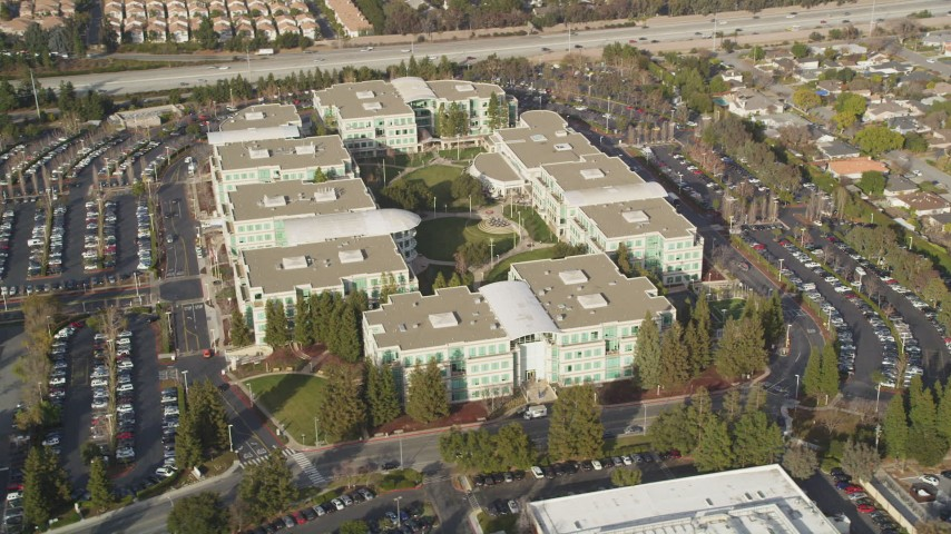 5K stock footage aerial video of tilting to reveal Apple Headquarters office buildings, Cupertino, California Aerial Stock Footage | DFKSF12_012
