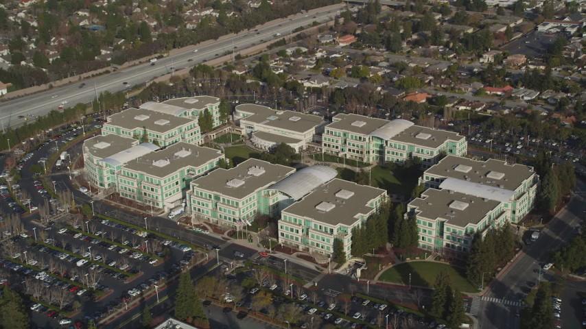 5K stock footage aerial video of orbiting Apple Headquarters office buildings, Cupertino, California Aerial Stock Footage | DFKSF12_013