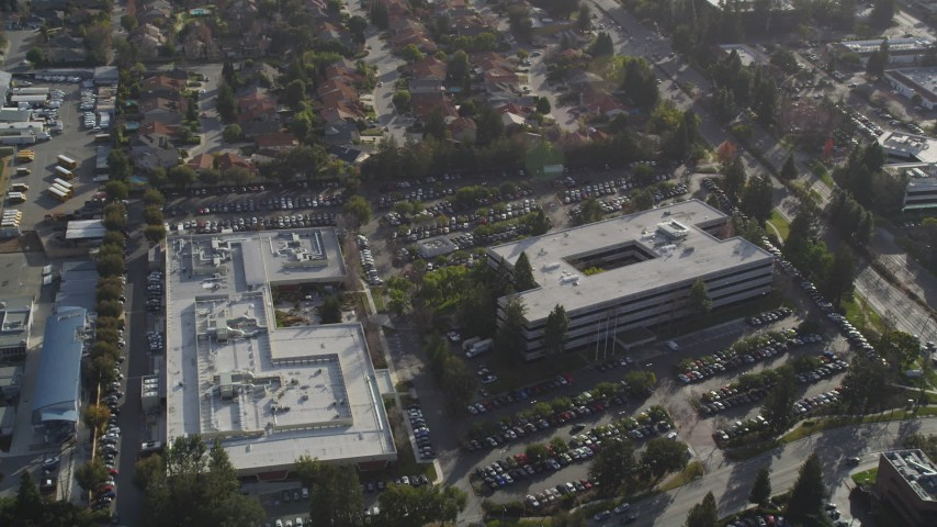 5K stock footage aerial video of flying over office buildings at Apple  Headquarters, Cupertino, California