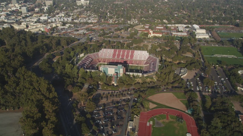 5K stock footage aerial video of approaching Stanford Stadium at Stanford University in Stanford, California Aerial Stock Footage | DFKSF12_029