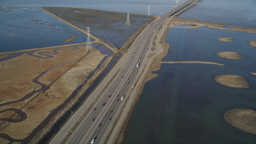 5K stock footage aerial video of flying over Highway 84 freeway, revealing Dumbarton Bridge, Menlo Park, California Aerial Stock Footage | DFKSF12_031