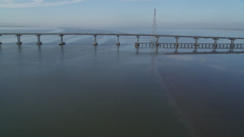 5K stock footage aerial video of approaching Dumbarton Bridge spanning San Francisco Bay, California Aerial Stock Footage | DFKSF12_033