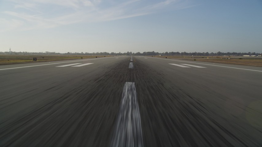 5K stock footage aerial video of approaching runway for landing at Oakland International Airport, California Aerial Stock Footage | DFKSF12_043