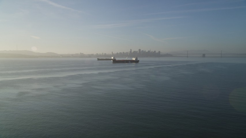 5K stock footage aerial video of approaching oil tankers in San Francisco Bay, San Francisco, California Aerial Stock Footage | DFKSF13_001