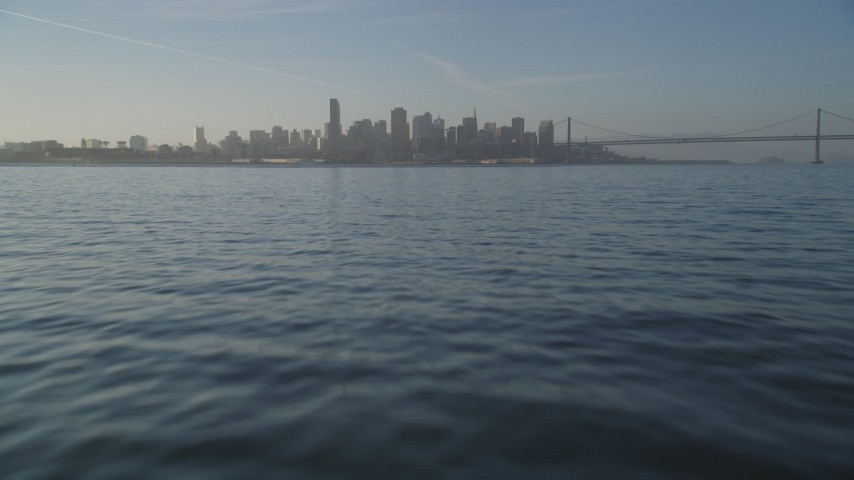 5K stock footage aerial video of tilting from the bay to reveal the Downtown San Francisco skyline, California Aerial Stock Footage | DFKSF13_007