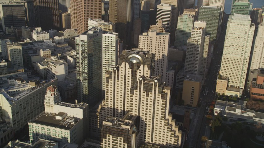 5K stock footage aerial video of a downtown hotel by skyscrapers in Downtown San Francisco, California Aerial Stock Footage | DFKSF13_021
