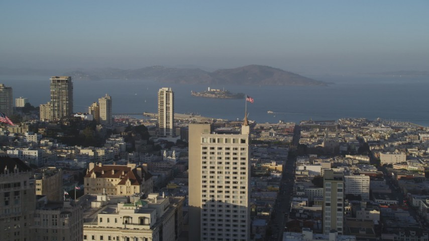 Fly by Russian Hill apartments, Alcatraz in distance, San Francisco, California Aerial Stock Footage | DFKSF13_026