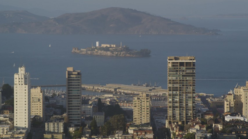 Flying by Alcatraz, seen from Russian Hill,  San Francisco, California Aerial Stock Footage | DFKSF13_027