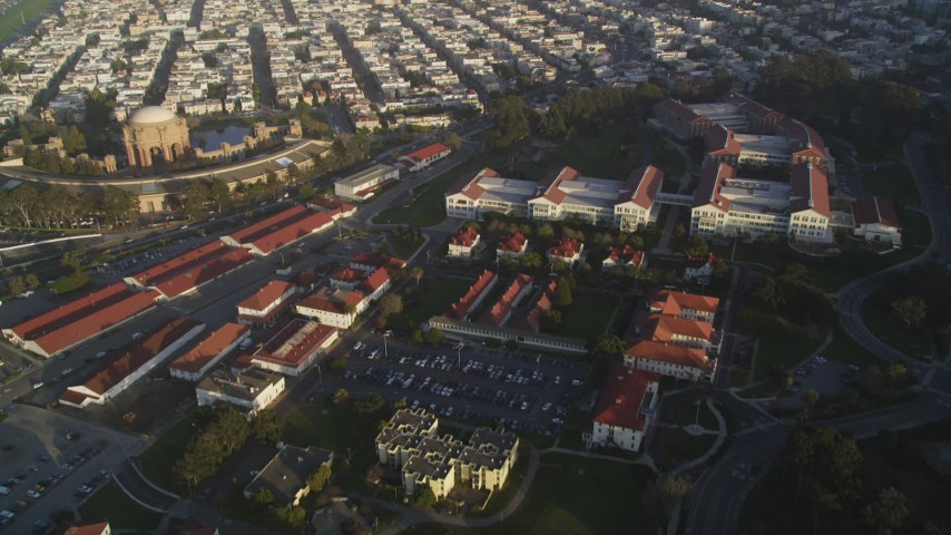 5K stock footage aerial video fly over film studio at The Presidio, reveal distant skyline of Downtown San Francisco, California Aerial Stock Footage | DFKSF13_039