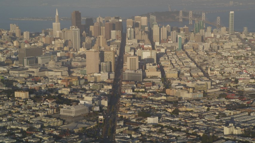 5K stock footage aerial video tilt from Market Street to reveal Downtown San Francisco skyscrapers, California Aerial Stock Footage | DFKSF13_049