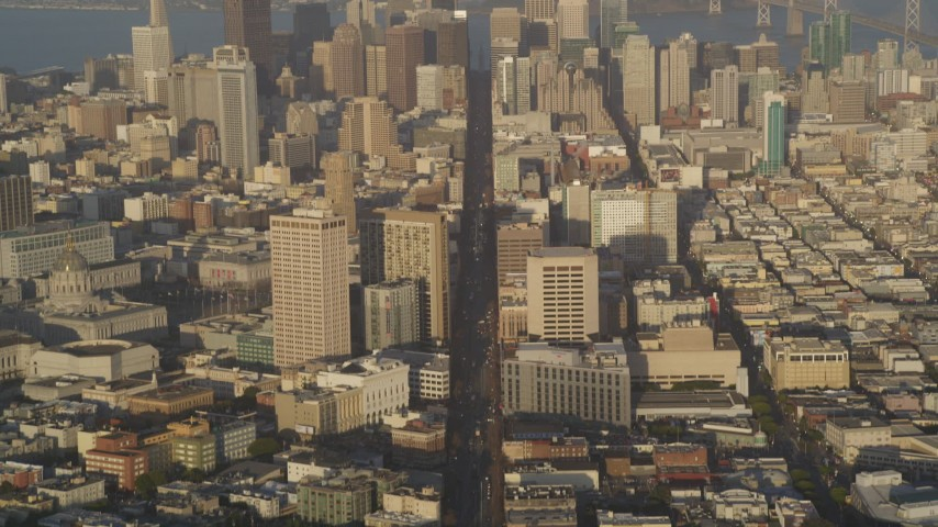 5K stock footage aerial video of flying over Market Street, tilt to reveal skyscrapers in Downtown San Francisco, California Aerial Stock Footage | DFKSF13_051