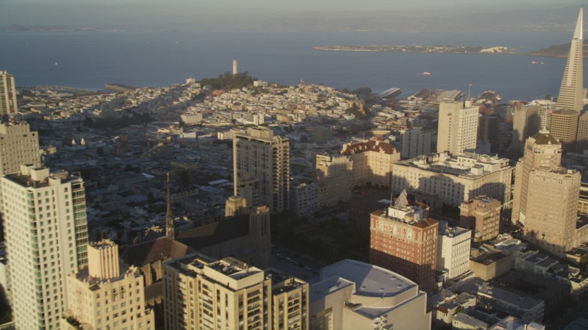 5K stock footage aerial video pan across Russian Hill and Nob Hill revealing Coit Tower in San Francisco, California Aerial Stock Footage | DFKSF13_056