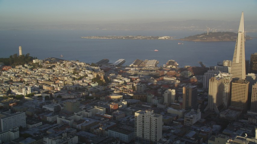 5K stock footage aerial video pan from Coit Tower and Treasure Island to Transamerica Pyramid in Downtown San Francisco, California Aerial Stock Footage | DFKSF13_057