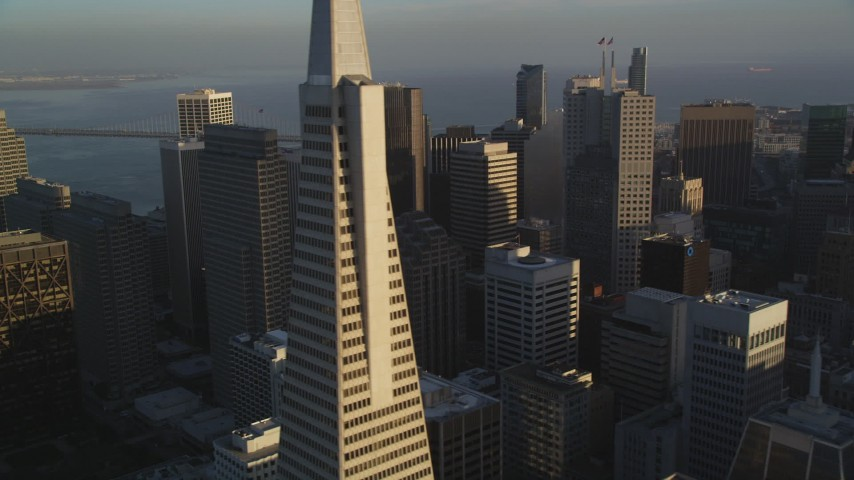 5K stock footage aerial video flyby skyscrapers and reveal the iconic Transamerica Pyramid, Downtown San Francisco, California Aerial Stock Footage | DFKSF13_058
