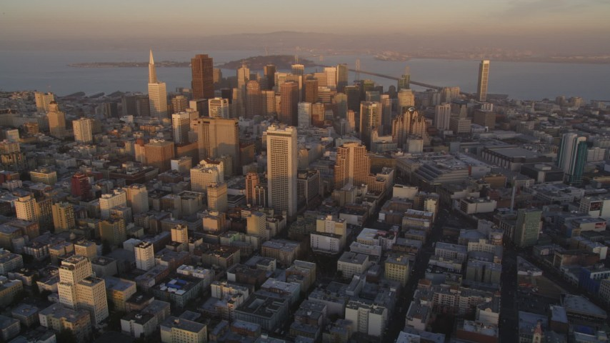 5K stock footage aerial video of approaching city skyscrapers from Civic Center, Downtown San Francisco, California, sunset Aerial Stock Footage | DFKSF14_004