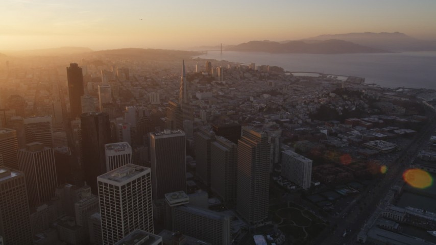 5K stock footage aerial video of panning across downtown buildings and skyscrapers in Downtown San Francisco, California, sunset Aerial Stock Footage | DFKSF14_006