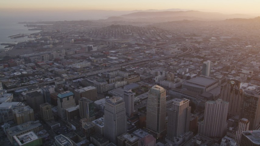 5K stock footage aerial video pan from South of Market to San Francisco Marriott Marquis hotel, Downtown San Francisco, sunset Aerial Stock Footage | DFKSF14_009