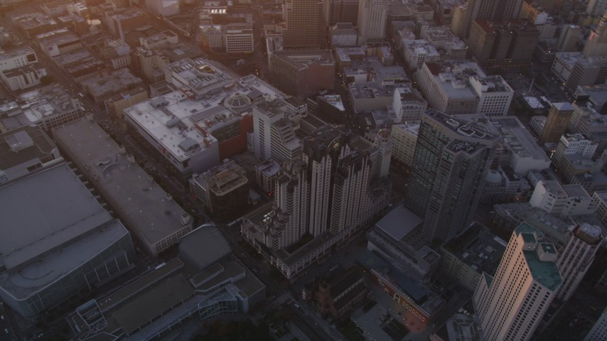5K stock footage aerial video orbit San Francisco Marriott Marquis hotel in Downtown San Francisco, California, sunset Aerial Stock Footage | DFKSF14_010