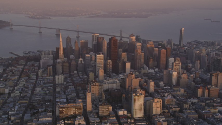 5K stock footage aerial video of a view of city buildings and skyscrapers in Downtown San Francisco, California, sunset Aerial Stock Footage | DFKSF14_012