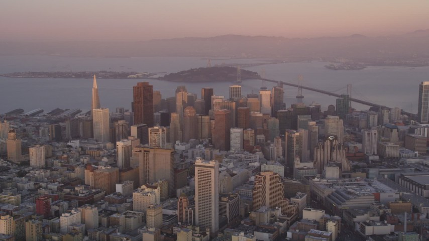 5K stock footage aerial video of an approach to skyscrapers in Downtown San Francisco, California, sunset Aerial Stock Footage | DFKSF14_014