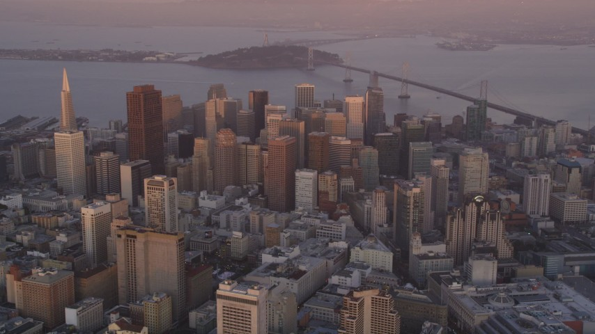 5K stock footage aerial video of flying toward city buildings and skyscrapers in Downtown San Francisco, California, sunset Aerial Stock Footage DFKSF14_015