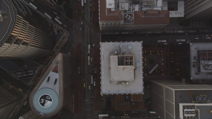 5K aerial video of a bird's eye view of city streets in Downtown San Francisco, California, sunset Aerial Stock Footage | DFKSF14_017