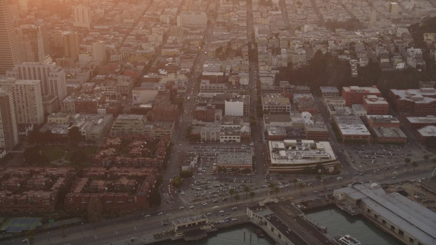 5K stock footage aerial video tilt from North Beach apartments, reveal iconic Coit Tower, San Francisco, California, sunset Aerial Stock Footage | DFKSF14_018